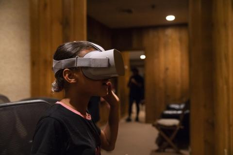 Student wearing a virtual reality headset