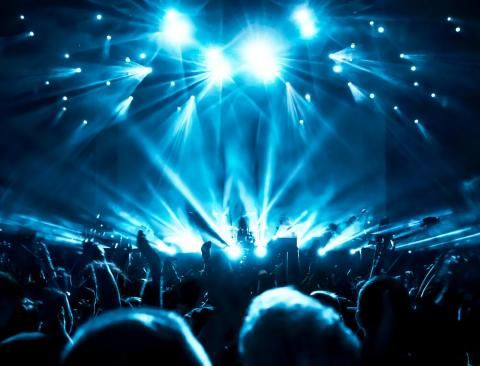 A stage lit in blue lights