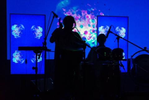 Backlit performer on stage