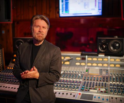 Stephen Webber stand in front of NEVE recording console in the Studio A Control Room at Power Station