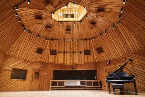 Photo of a Grand Piano inside a large studio live room